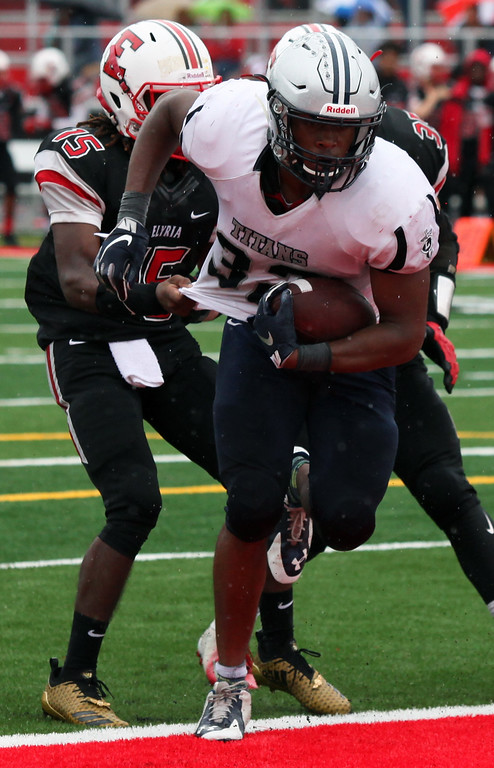 . Randy Meyers - The Morning Journal<br> Lorain running back Savon Chavis breaks several tackles by the Elyria defense and scores a second quarter touchdown on Sept.  8.