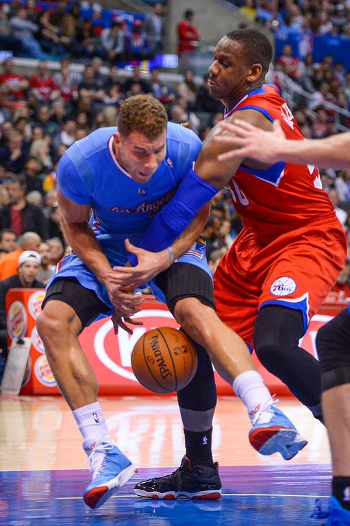 . Clippers� Blake Griffin is fouled by 76ers� Lavoy Allen during first half action at Staples Center Sunday.  ( Photo by David Crane/Los Angeles Daily News )