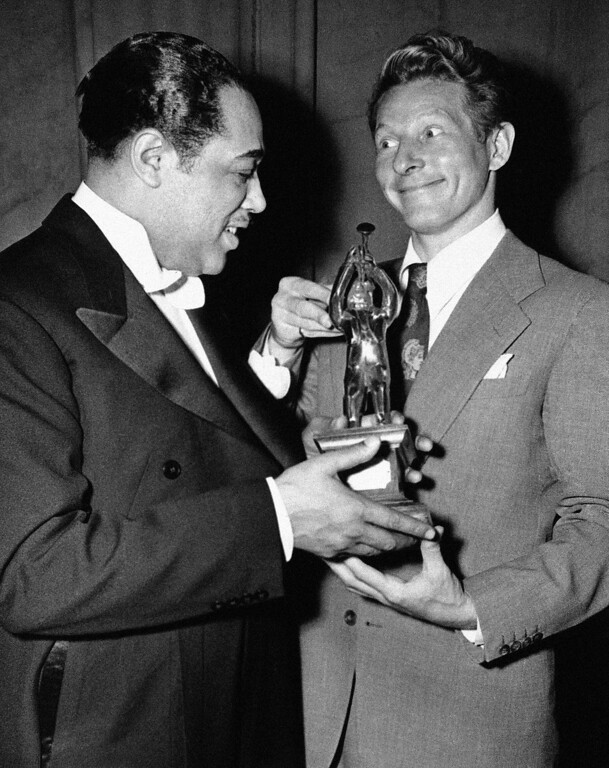 . Bandleader-composer Duke Ellington receives an ?Oscar? from Danny Kaye, who was master of ceremonies for Esquire magazine?s 1945 All-American Jazz concert at the Los Angeles Philharmonic auditorium on Jan. 23, 1945. Ellington was the official choice of all the judges in the annual swing contest. (AP Photo)