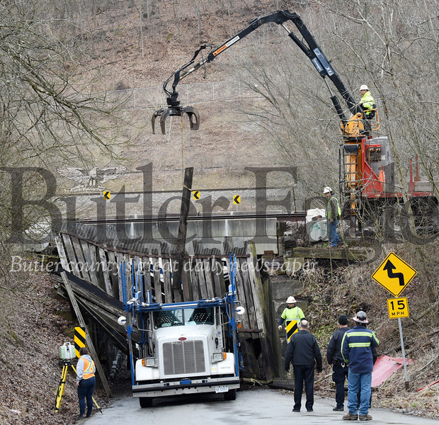 Harold Aughton/Butler Eagle:  A car carrier became stuck as it attempted to travel under the railroad bridge on McCalmont Road in Penn Township, Monday, February 25, 2020.