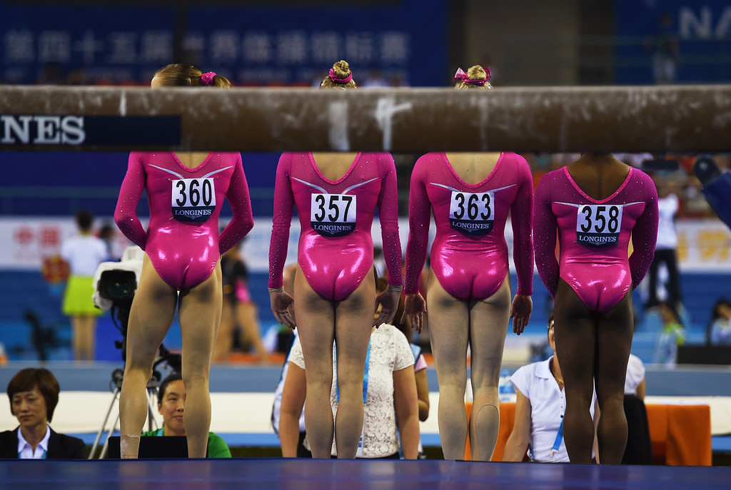 . Members of the US team (L-R) Madison Kocian, Alyssa Baumann, Mykayla Skinner and Simone Biles stand in front of judges before competing on the beam during the women\'s qualification at the Gymnastics World Championships in Nanning, in China\'s southern Guangxi province on October 5, 2014. GREG BAKER/AFP/Getty Images