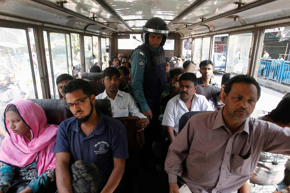 . A policeman raids a bus after activists from Bangladesh\'s Jamaat-e-Islami set fire on a street during the first day of a two-day-long strike to protest against the decision by the country\'s war crimes tribunal to deliver judgement in the cases involving their top leaders in Dhaka on March 3, 2013. REUTERS/Andrew Biraj