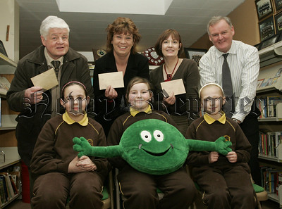 Joan Withers (NSPCC), Gail McKee (British Heart Foundation) and Danny Hollywood (St. Vincent de Paul) are pictured recieving cheques from  Chloe Reel, Enya McAteer and Caroline Mathers pupils at St Joseph's P.S. Meigh. Over £2000 was raised as part of a fitness fundraising campaign held witin the school before Christmas. Also pictured is school Principal Mr Brian McKinley. 07W6N5