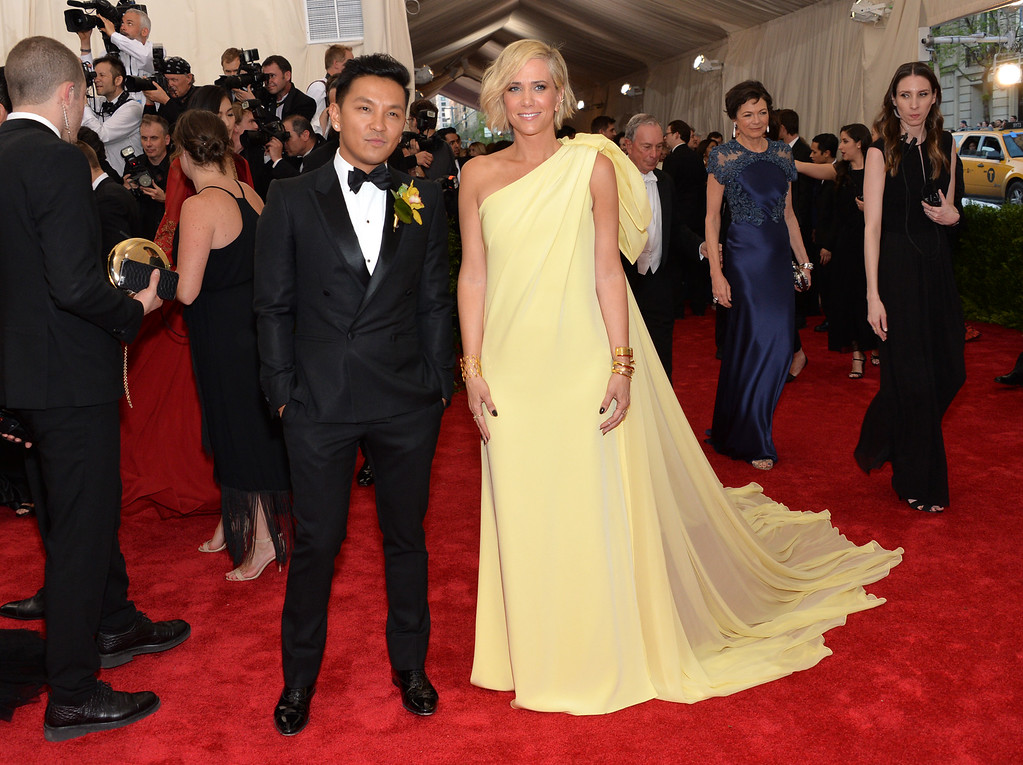 """. Designer Prabal Gurung, left, and Kristen Wiig arrive at The Metropolitan Museum of Art\'s Costume Institute benefit gala celebrating \""""China: Through the Looking Glass\"""" on Monday, May 4, 2015, in New York. (Photo by Evan Agostini/Invision/AP)"""