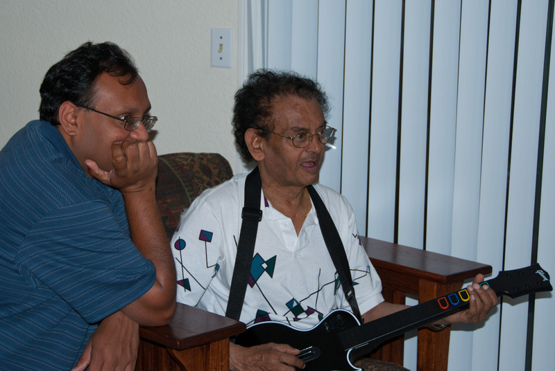 Pritesh and Dad play Guitar Hero