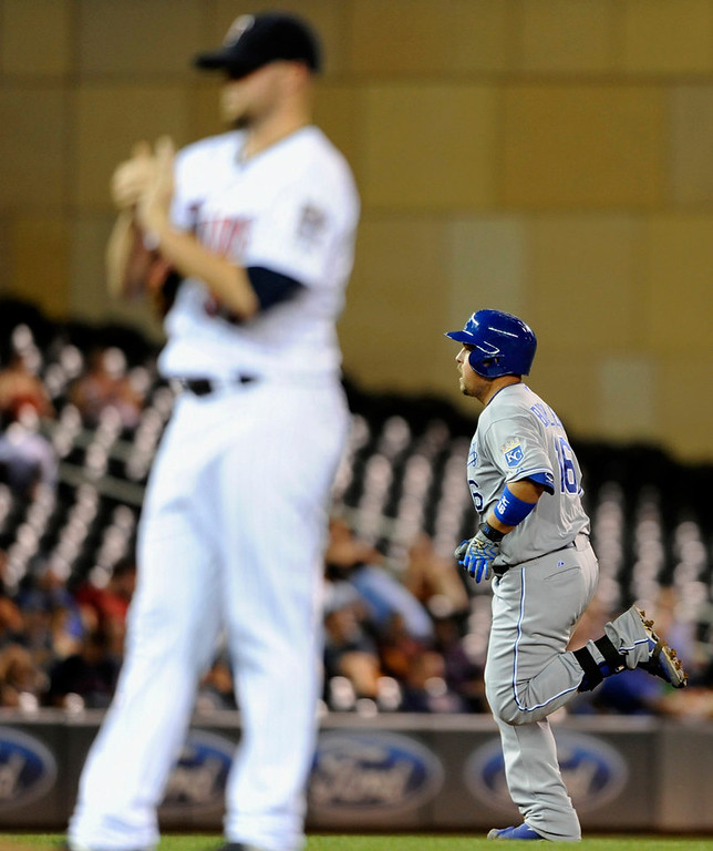 . Ryan Pressly #57 of the Minnesota Twins reacts as Billy Butler #16 of the Kansas City Royals rounds the bases after he hit a solo home run during the ninth inning. (Photo by Hannah Foslien/Getty Images)