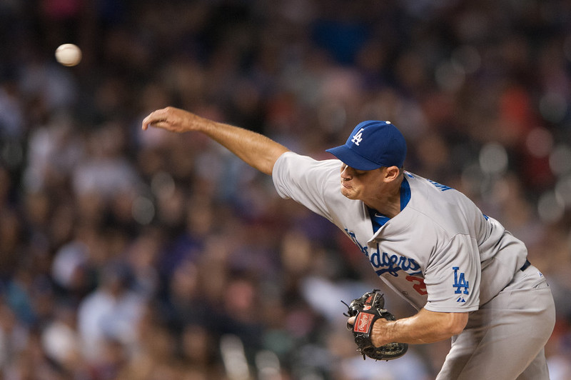 . Jamey Wright #28 of the Los Angeles Dodgers pitches against the Colorado Rockies in the fifth inning of a game at Coors Field on September 15, 2014 in Denver, Colorado.  (Photo by Dustin Bradford/Getty Images)