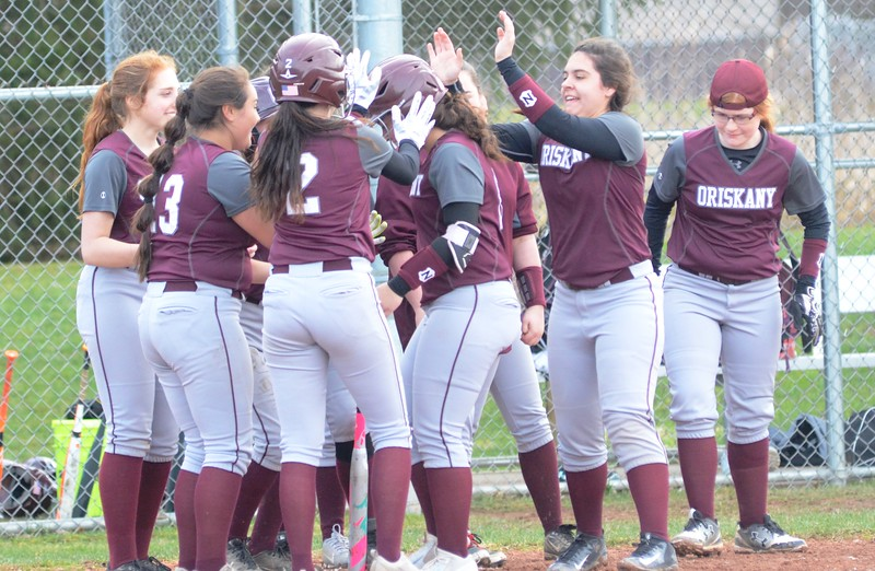 John Brewer - Oneida Daily Dispatch Oriskany teammates mob Phelan Shannon after she hit a grand slam against Stockbridge Valley on Friday, April 28.