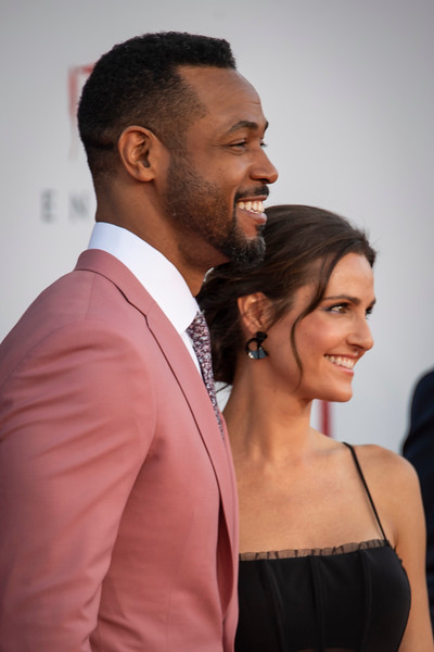 "WESTWOOD, CA - AUGUST 26: Isaiah Mustafa and Lisa Mitchell attend the Premiere Of Warner Bros. Pictures' ""It Chapter Two"" at Regency Village Theatre on Monday, August 26, 2019 in Westwood, California. (Photo by Tom Sorensen/Moovieboy Pictures)"