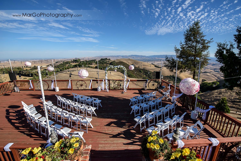 backyard wedding ceremony side with hills view