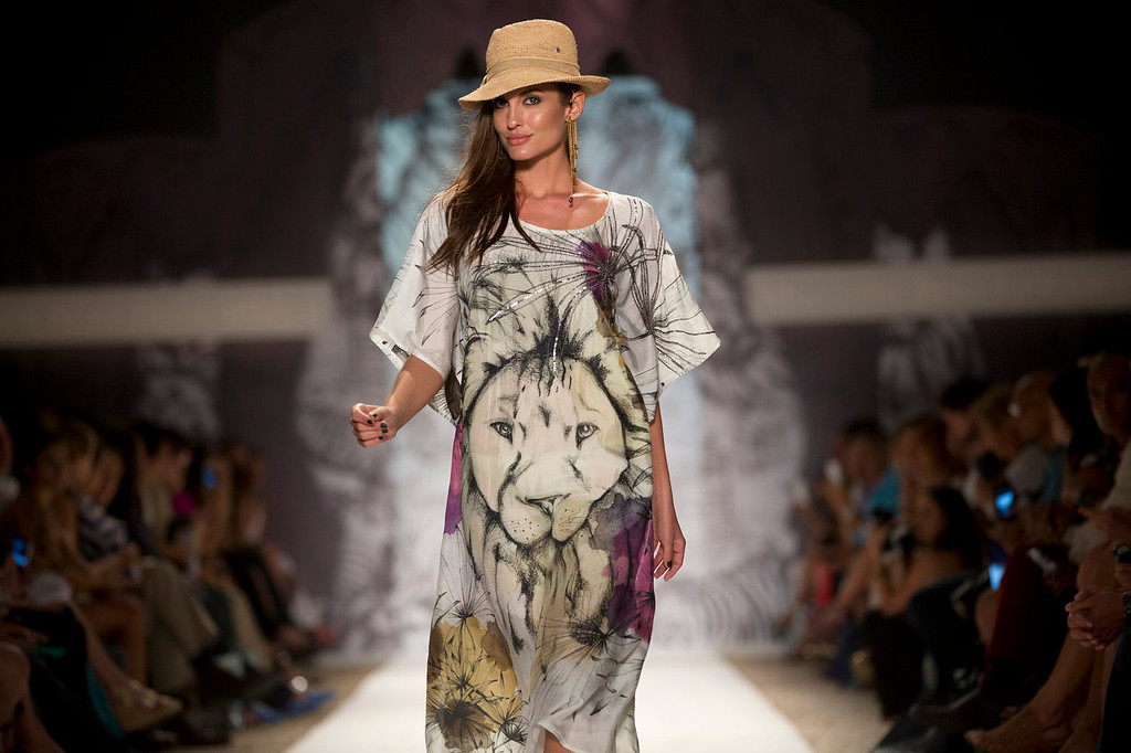 . In this Friday, July 19, 2013 photo, a model walks the runway during the Agua Bendita show at the Mercedes-Benz Fashion Week Swim show in Miami Beach, Fla. (AP Photo/J Pat Carter)