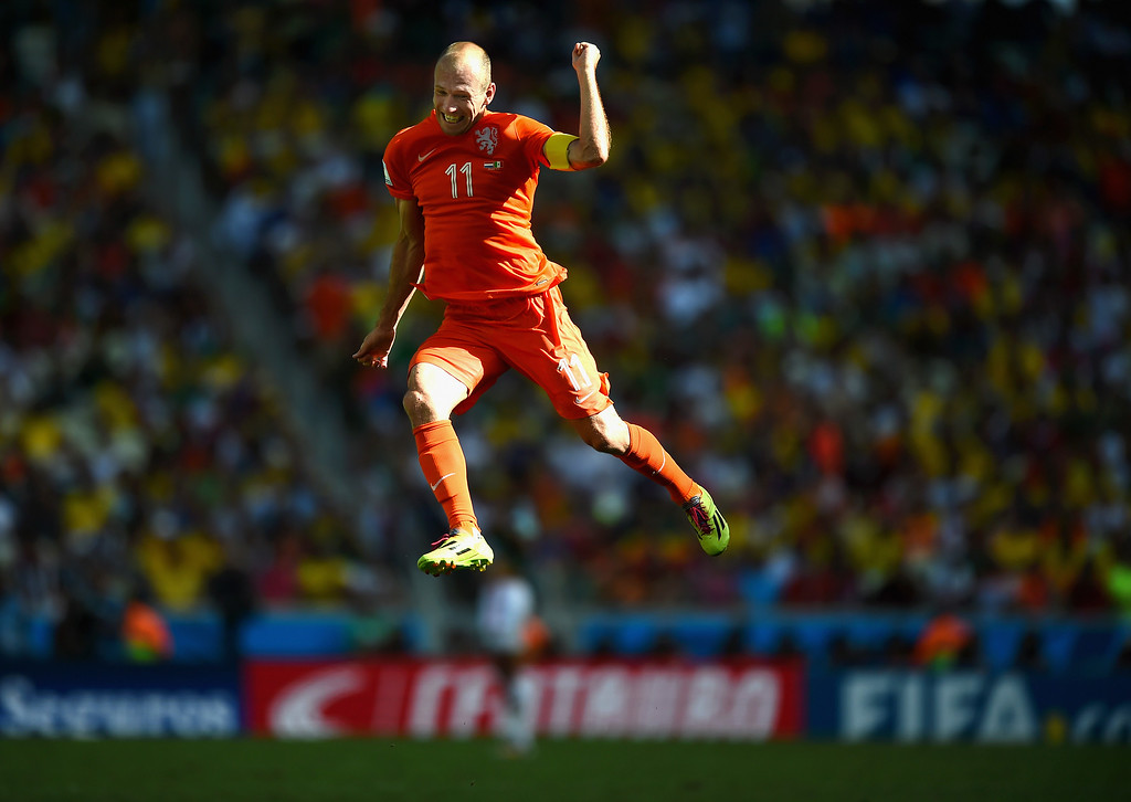 . Arjen Robben of the Netherlands celebrates after defeating Mexico 2-1 during the 2014 FIFA World Cup Brazil Round of 16 match between Netherlands and Mexico at Castelao on June 29, 2014 in Fortaleza, Brazil.  (Photo by Laurence Griffiths/Getty Images)