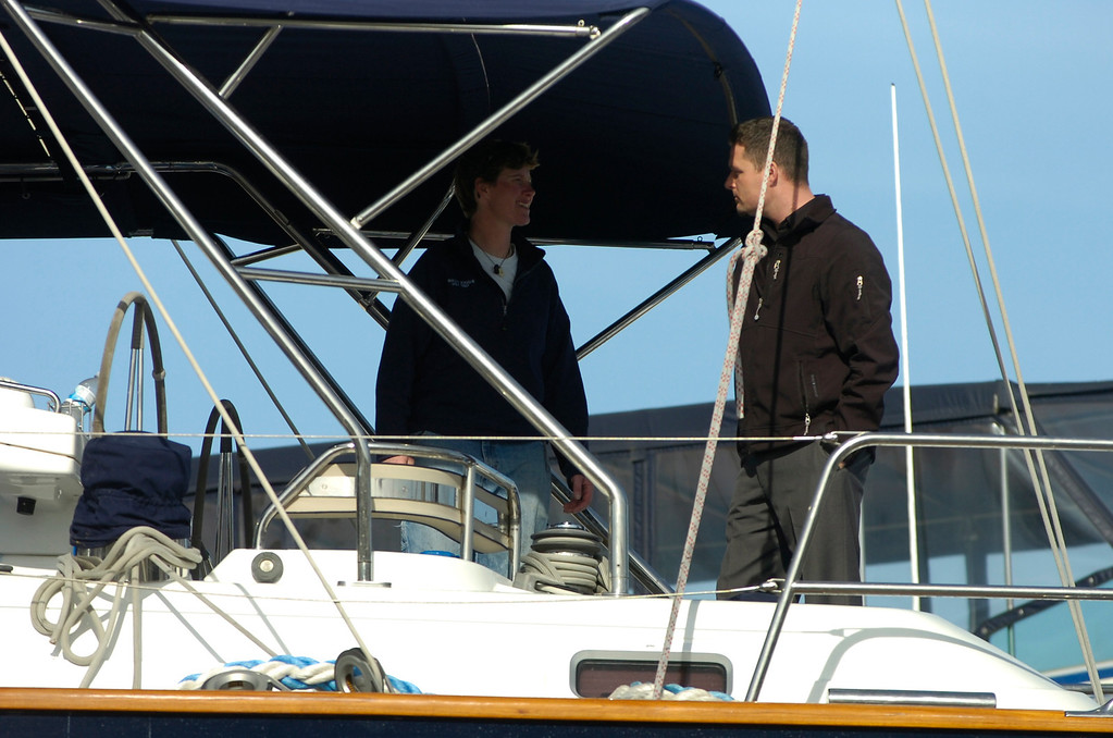 . Two people talk aboard the Darling at the Bay Marine Boatworks yard in Richmond, Calif. on Tuesday, March 5, 2013. The Darling was stolen from a Sausalito marina, then ran aground in Pacifica on Monday. (Kristopher Skinner/Staff)