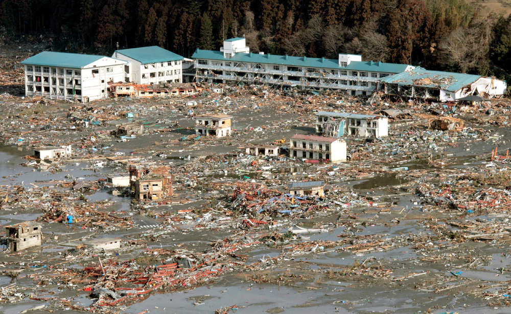 . Urban area devastated by tsunami is seen in Rikuzentakata, Iwate, northern Japan Saturday, March 12, 2011 after Japan\'s biggest recorded earthquake slammed into its eastern coast Friday. (AP Photo/Kyodo News)