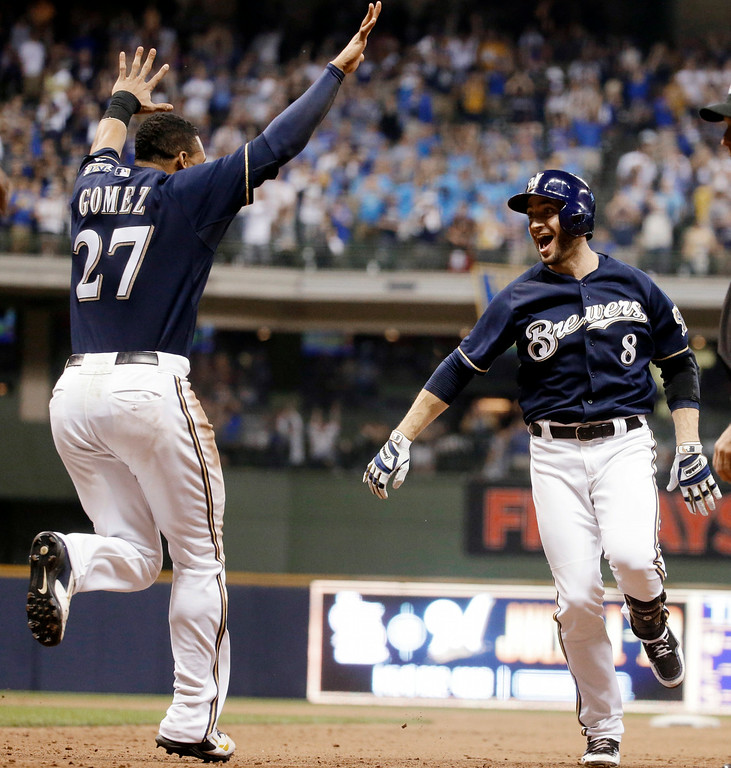 . Milwaukee Brewers\' Ryan Braun reacts after hitting a game-winning single during the ninth inning of a baseball game against the Colorado Rockies Friday, June 27, 2014, in Milwaukee. The Brewers won 3-2. (AP Photo/Morry Gash)
