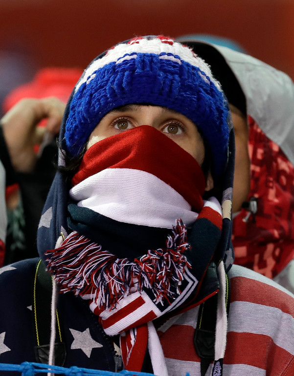 . A USA fan watches during the women\'s moguls qualifying at Phoenix Snow Park at the 2018 Winter Olympics in Pyeongchang, South Korea, Sunday, Feb. 11, 2018. (AP Photo/Kin Cheung)
