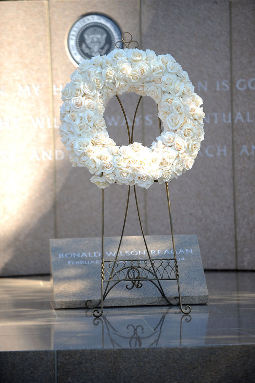 . File - A presidential wreath sits at Ronald Reagan\'s resting place during an event marking the 102nd Anniversary of Presidential Ronald Reagan\'s Birthday Wednesday, February 6, 2013 at the Ronald Reagan Presidential Library. (Andy Holzman/Los Angeles Daily News)