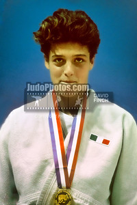 1989 Belgrade Worlds  891012A1107 Saturday:  Emanuela Pierantozzi of Italy happily wearing her u66kgs gold medal during the day 3 medals session.....