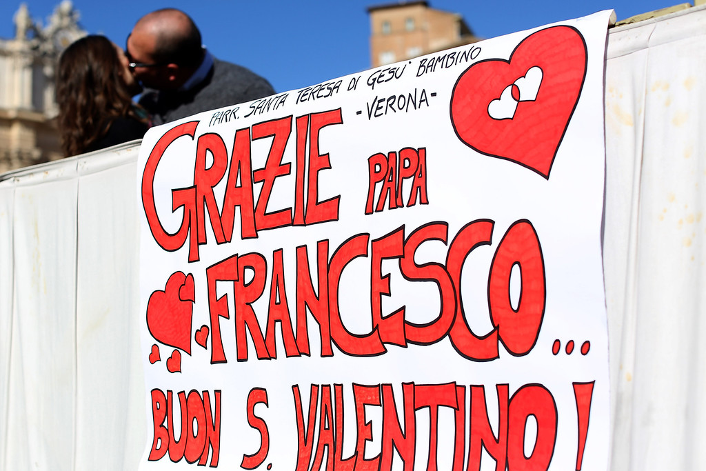 . Engaged couples from all over the world gathered today, on the feast of St. Valentine, in St. Peter\'s Square attend a special meeting with Pope Francis Basilica on February 14, 2014 in Vatican City, Vatican. (Photo by Franco Origlia/Getty Images)