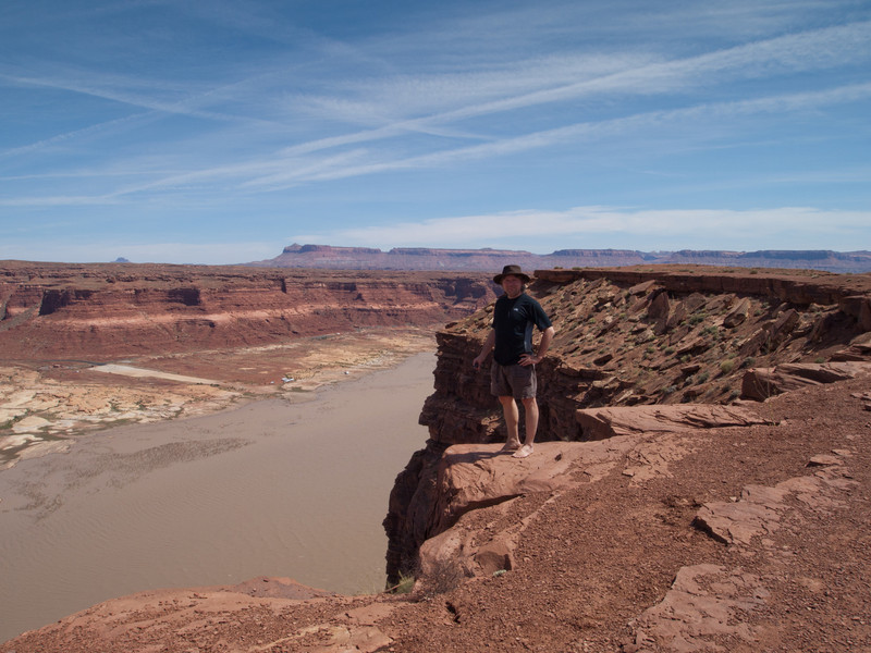 Roger at Hite Overlook.  The little white things on the other side of the water are RVs.