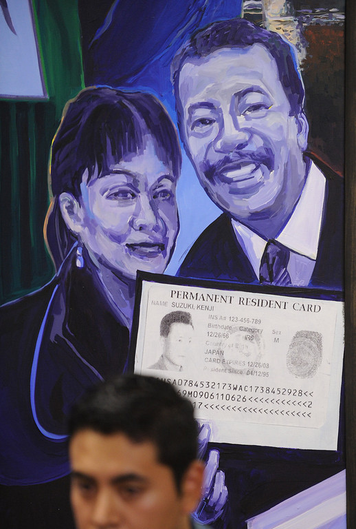 . A mural on the wall at the press conference shows a permanent resident card. The state Legislature passed AB60, a bill allowing undocumented immigrants to have driver\'s licenses in California. A group of un-licensed drivers held a press conference at the Coalition for Humane Immigrant Rights Los Angeles, to talk about the problems they have encountered while driving without licenses. Los Angeles, CA. 9/13/2013. photo by (John McCoy/Los Angeles Daily News)