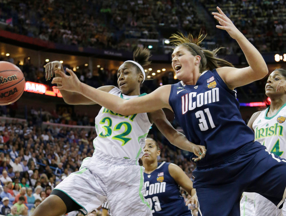 . Connecticut center Stefanie Dolson (31) and Notre Dame guard Jewell Loyd (32) go after a loose ball in the first half of the women\'s NCAA Final Four college basketball tournament semifinal, Sunday, April 7, 2013, in New Orleans. (AP Photo/Gerald Herbert)