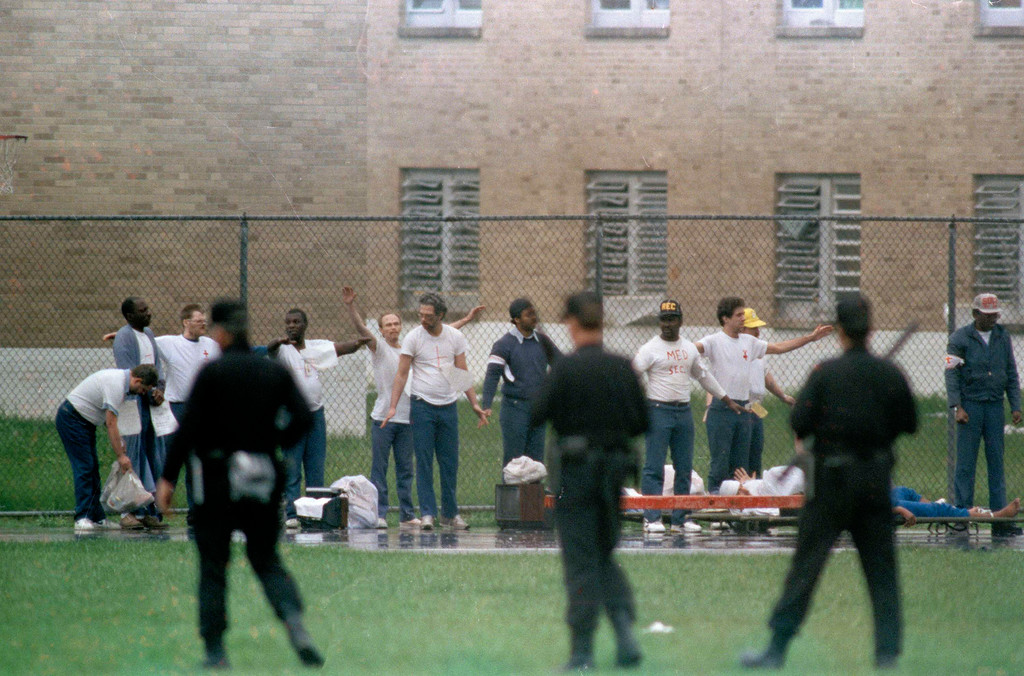 . FILE - This April 21, 1993 file photo shows inmates raising their hands in surrender as armed guards watch on the recreation yard of the Southern Ohio Correctional Facility in Lucasville, Ohio. In the 20 years since the nation\'s longest deadly prison riot broke out in Lucasville, no interviews have been granted with the five men sentenced to death in the killing of a guard. Yet time has brought new evidence and insights that will dominate events marking the 20th anniversary of the 11-day siege of April 1993. (AP Photo/Lennox McLendon, File)