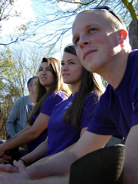 Tyler Willoughby, Erin Mackie, and Sarah Davis take a break in the shade and check out the Safari animals at Busch Gardens during Choir Tour.