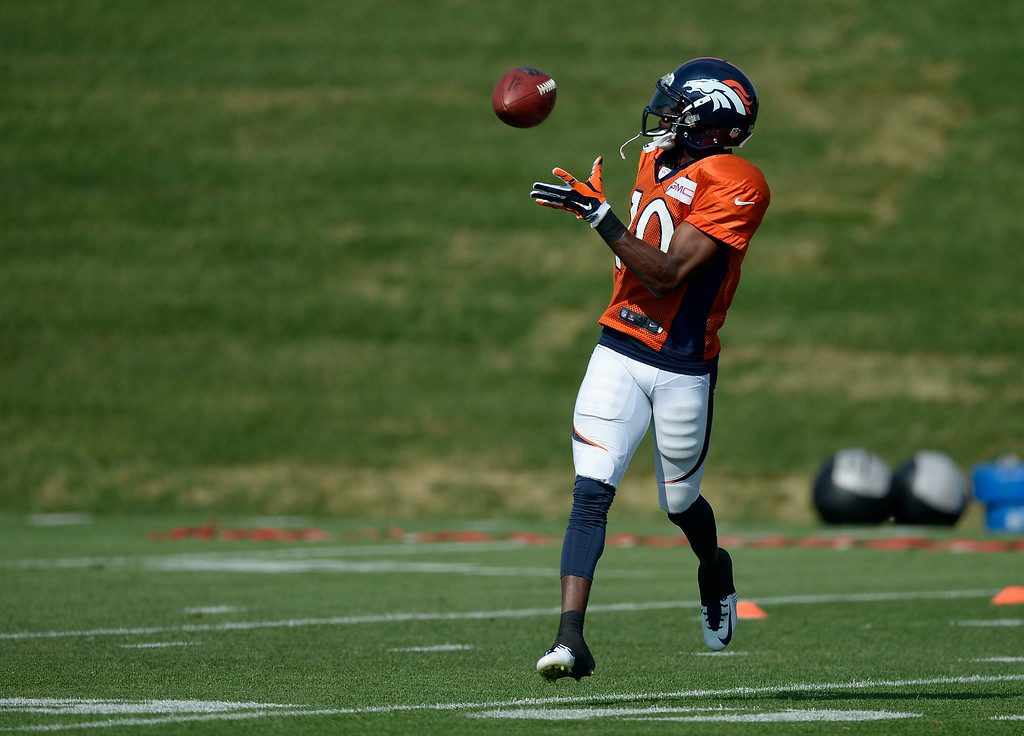 . Denver Broncos wide receiver Emmanuel Sanders (10) catches a pass during drills on day five of the Denver Broncos 2014 training camp July 28, 2014 at Dove Valley. (Photo by John Leyba/The Denver Post)