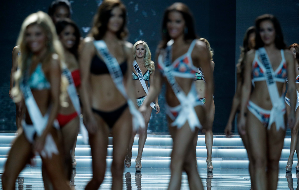 . Miss Vermont USA Madison Cota, center, walks on stage with other contestants during the Miss USA contest Sunday, May 14, 2017, in Las Vegas. (AP Photo/John Locher)
