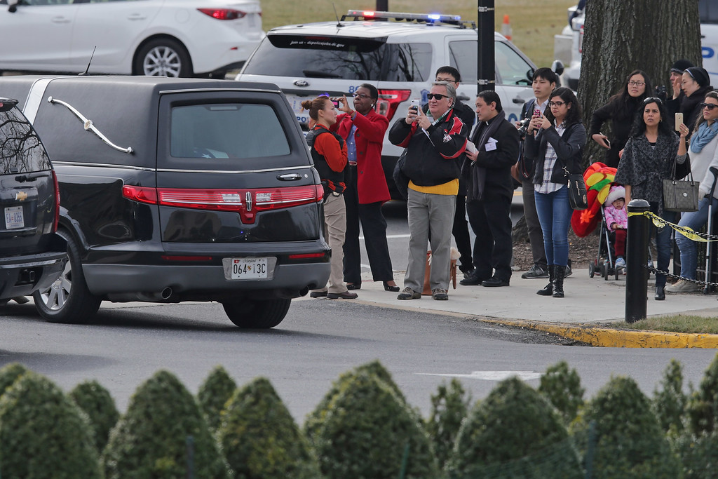 . Members of the public make photographs of the hearse carrying U.S. Supreme Court Associate Justice Antonin Scalia\'s remains as it leaves the Basilica of the National Shrine of the Immaculate Conception following his funeral February 20, 2016 in Washington, DC. Scalia, who died February 13 while on a hunting trip in Texas, laid in repose in the Great Hall of the Supreme Court on Friday and his funeral service will be at the basilica today.  (Photo by Chip Somodevilla/Getty Images)