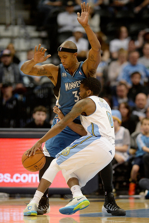 . Dante Cunningham (33) of the Minnesota Timberwolves lays out Aaron Brooks (0) of the Denver Nuggets during the second half of the Timberwolves\' 132-128 win. (Photo By AAron Ontiveroz/The Denver Post)
