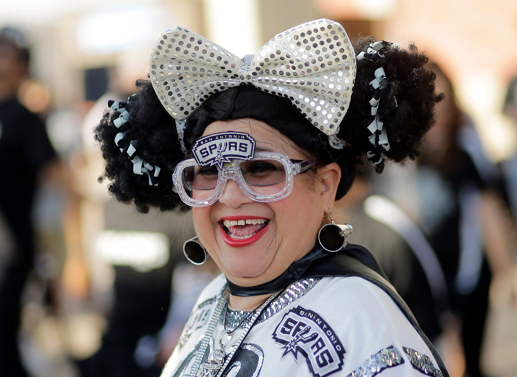 . San Antonio Spurs fan Sovia Lauflano dances outside the AT&T Center prior to Game 5 of a Western Conference finals NBA basketball playoff series between the Spurs and the Oklahoma City Thunder, Thursday, May 29, 2014, in San Antonio. (AP Photo/Eric Gay)