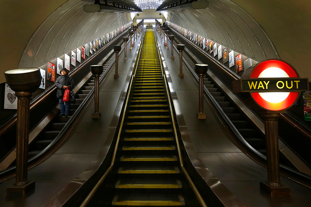 Description of . A passenger uses the escalator to the platforms at St John's Wood Underground Station, in London on January 9, 2013. The London Underground celebrates 150 years since the first underground journey took place on January 9, 1863.  REUTERS/Andrew Winning