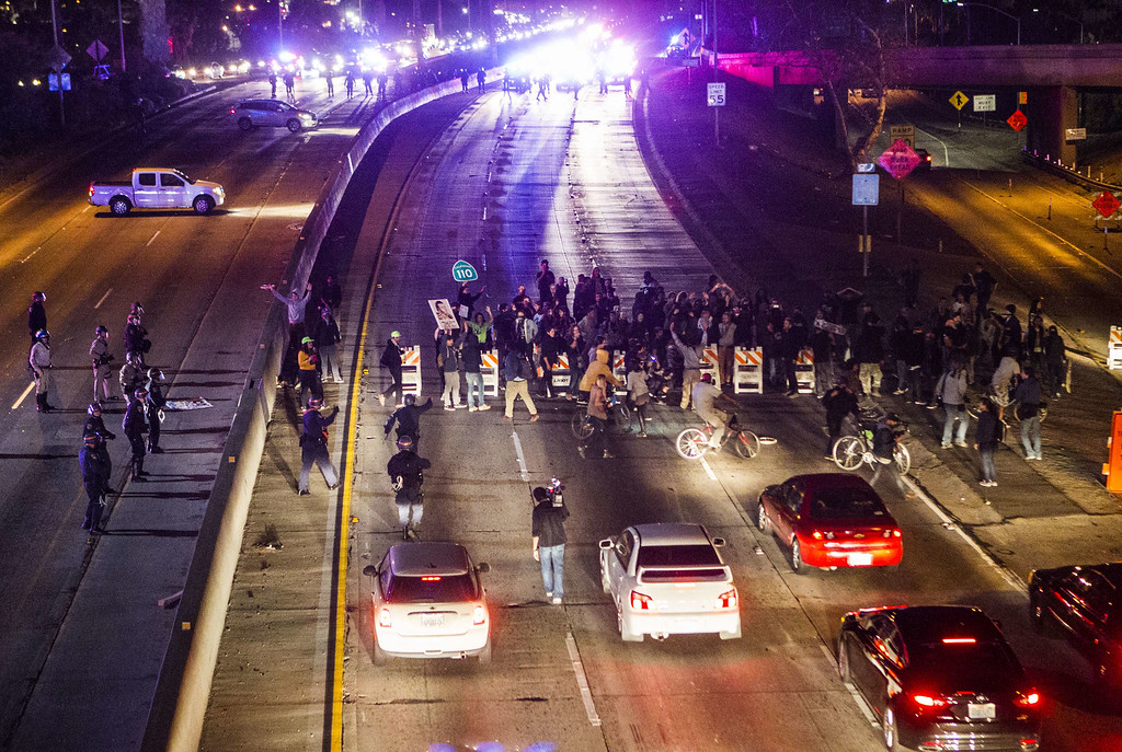 . Demonstrators block a freeway on November 25, 2014 in Los Angeles during demonstrations against a decision by a Ferguson, Missouri grand jury to not indict a white police officer in the shooting of black teenager Michael Brown.  Violent protests and looting erupted in the US town of Ferguson for a second day after the grand jury\'s decision. AFP PHOTO / Ringo  CHIU/AFP/Getty Images