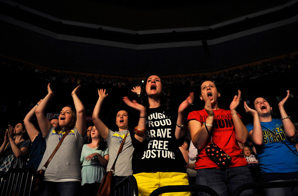 . Concert goers react to hearing Boston Bombing survivor Victoria McGrath address the crowd during the Boston Strong benefit concert at the Boston TD Garden in Boston, May 30, 2013. Proceeds from the concert will go to the One Fund, which was established in the wake of the Boston Marathon bombings to help survivors and victims\' families. REUTERS/Gretchen Ertl