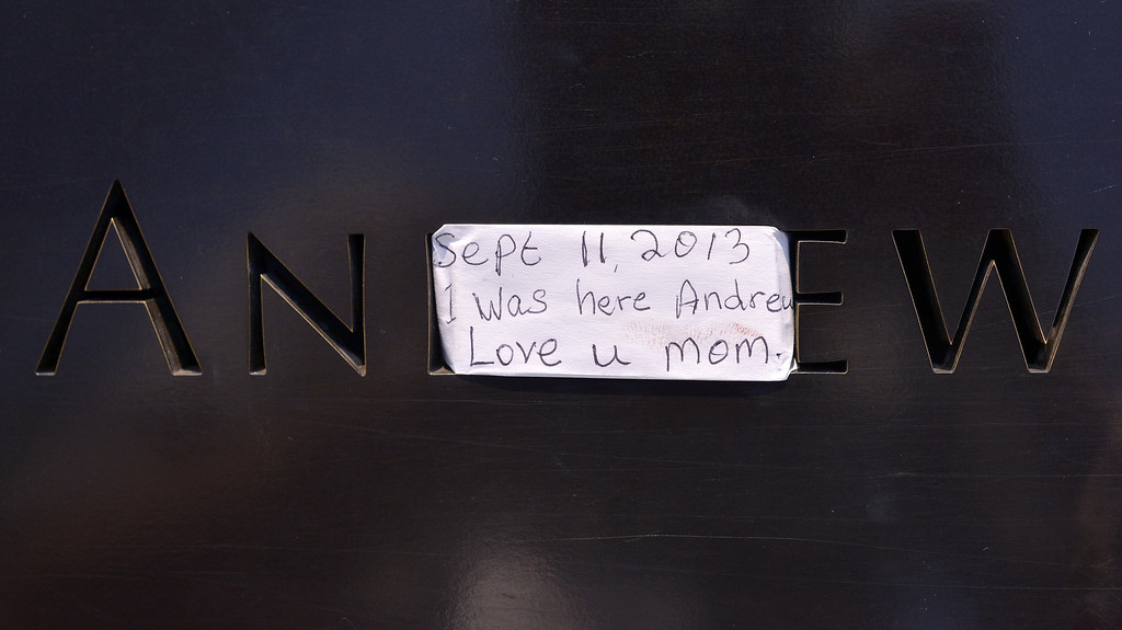 . A view of a note left on a name at the North Pool at the 9/11 Memorial during ceremonies for the twelfth anniversary of the terrorist attacks on lower Manhattan at the World Trade Center site on September 11, 2013 in New York City.  (Photo by Justin Lane-Pool/Getty Images)