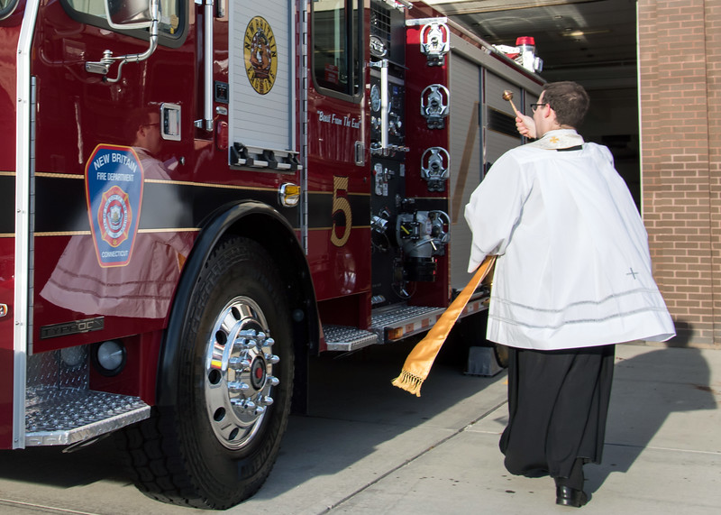 11/14/18  Wesley Bunnell | Staff  The New Britain Fire Department unveiled three new fire trucks on Wednesday afternoon during a ceremony at their Beaver St headquarters. Fr. Michael Casey, Pastor of St. Frances and CCSU Chaplain, blesses the new fire trucks with holy water.