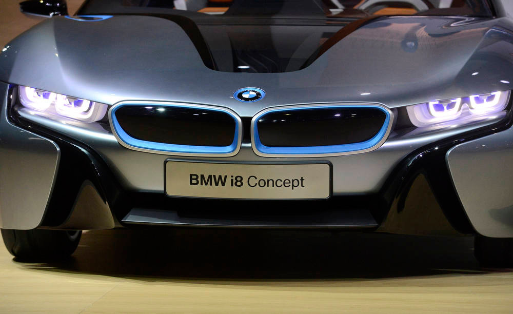 Description of . The BMW i8 concept car is displayed during a news conference at the 2012 Los Angeles Auto Show in Los Angeles, California November 28, 2012.  REUTERS/Phil McCarten