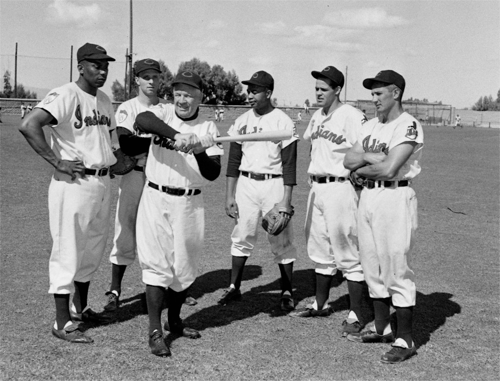 . Graduates from batting school at the Cleveland Indians training camp watch Tris Speaker demonstrate.  Left to right:  Luke Easter, first baseman; Jim Hegan, catcher; Larry Doby, outfielder; Ray Boone, shortstop; Al Rosen, third baseman, February 28, 1952.(AP Photo)