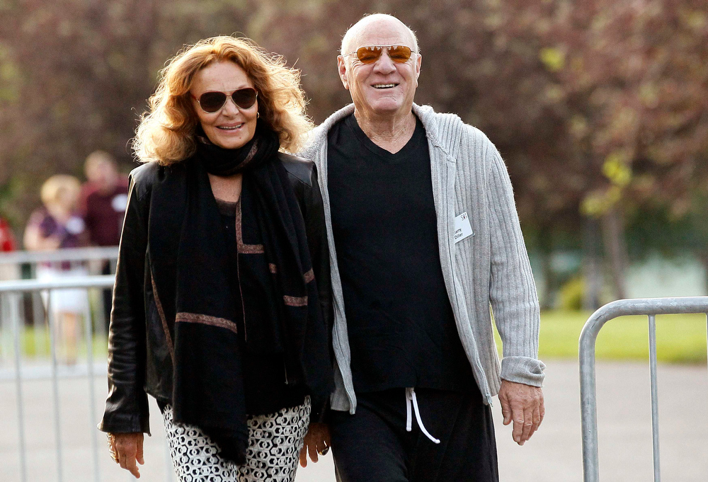 . Barry Diller, chairman of IAC/InterActive Corp (R), with wife Diane von Furstenberg, arrives for the first session of annual Allen and Co. conference at the Sun Valley, Idaho Resort July 10, 2013.  REUTERS/Rick Wilking