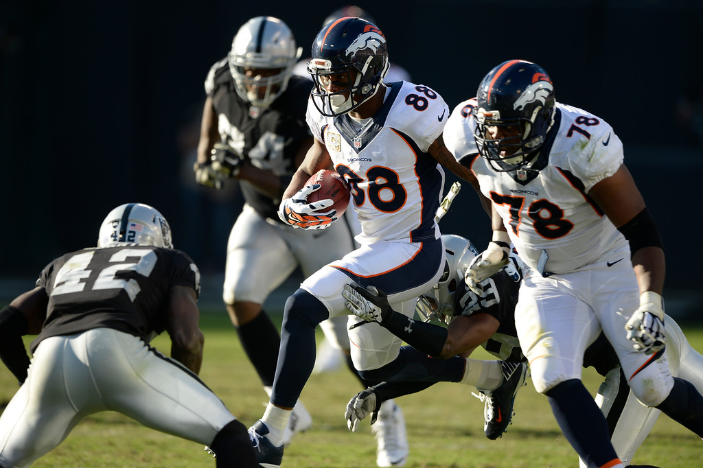 . OAKLAND, CA. - NOVEMBER 09: Denver Broncos wide receiver Demaryius Thomas (88) picks up a few yards in the third quarter against the Oakland Raiders November 9, 2014 at O.co Coliseum. (Photo By John Leyba/The Denver Post)