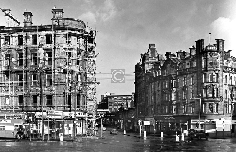Near the end for the Victoria Building at the corner of Clyde St and Stockwell St, making way for Carrick Quay. The future looked uncertain for the handsome block on the right, but happily it has survived.   January 1977.