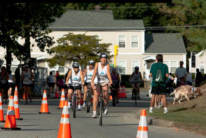Abby, Gennie, and Jonie return from the bike course.
