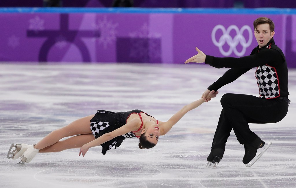 . Valentina Marchei and Ondrej Hotarek of Italy perform in the team event pair skating in the Gangneung Ice Arena at the 2018 Winter Olympics in Gangneung, South Korea, Sunday, Feb. 11, 2018. (AP Photo/Julie Jacobson)