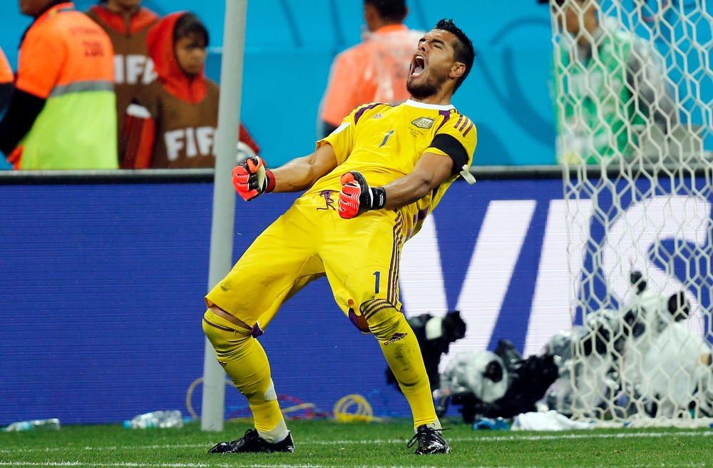 . Argentina\'s goalkeeper Sergio Romero celebrates after he saved shot by Netherlands\' Wesley Sneijder from the spot during the World Cup semifinal soccer match between the Netherlands and Argentina at the Itaquerao Stadium in Sao Paulo, Brazil, Wednesday, July 9, 2014. Argentina beat the Netherlands 4-2 in a penalty shootout to reach the World Cup final. (AP Photo/Frank Augstein)