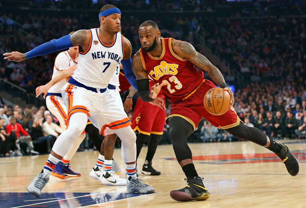. Cleveland Cavaliers forward LeBron James (23) drives to the basket with New York Knicks forward Carmelo Anthony (7) defending in the first quarter of an NBA basketball game at Madison Square Garden in New York, Wednesday, Dec. 7, 2016. (AP Photo/Kathy Willens)