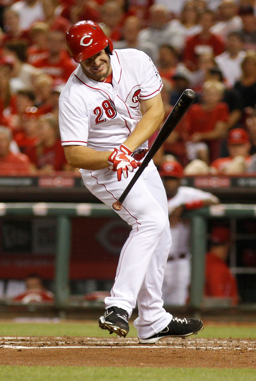 . Cincinnati Reds\' Chris Heisey reacts after being hit by a pitch from Los Angeles Dodgers pitcher Clayton Kershaw in the third inning of a baseball game, Sunday, Sept. 8, 2013, in Cincinnati. (AP Photo/David Kohl)