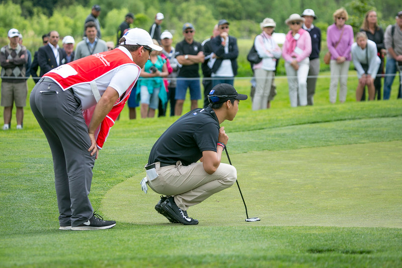 Min Woo Lee from Australia and his caddy line up a putt on the 6th hole on the final day of the Asia-Pacific Amateur Championship tournament 2017 held at Royal Wellington Golf Club, in Heretaunga, Upper Hutt, New Zealand from 26 - 29 October 2017. Copyright John Mathews 2017.   www.megasportmedia.co.nz