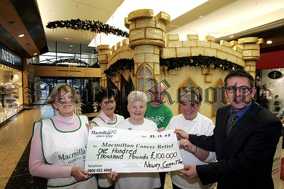 The Macmillan Cancer Relief team from Newry, Patrrica Smith, Sarah McKeown, Mary Grant, Martha McGrath, and Aidan Carroll present the cheque for £10,000 to Paul Sweeney. 06W1N5